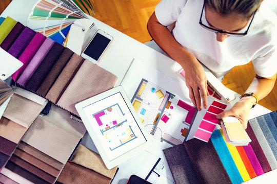 Architect, interior designer, looking at samples