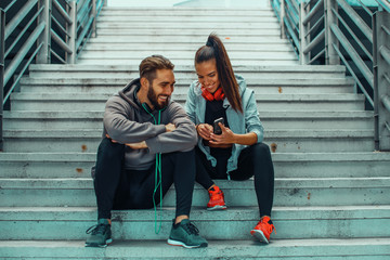 Young couple choosing music before running