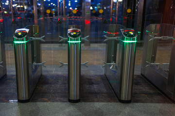 Automatic barriers for control people entered in railway station or in metro, red and green light, necessary tickets, new technologies in habitual life, automatic open and close doors