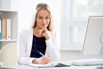 Young beautiful business woman with computer