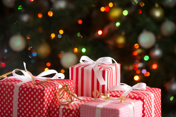 Christmas gifts on festive lights background