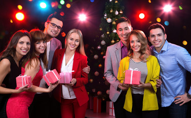 Group of young people with holiday gifts