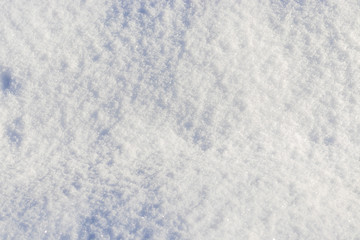 natural winter snow texture close-up as background.