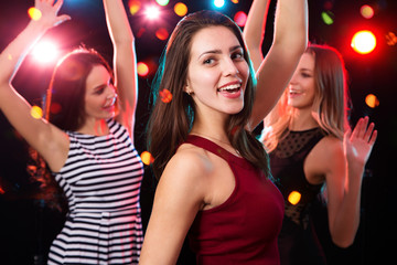 Beautiful girls have fun at a Christmas party