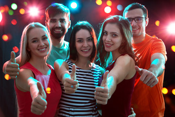 People showing OK sign in the night club