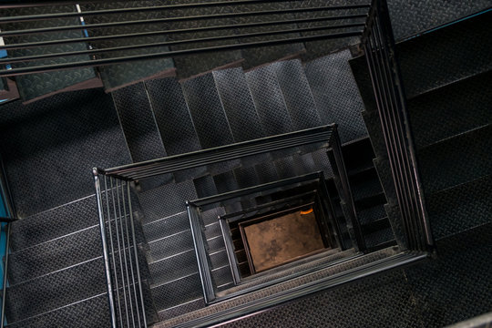 Square steel stairwell view from the top.