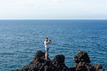 Tourist taking selfie on the background of the sea.