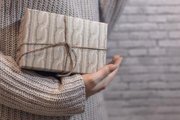 vintage textured gift in female hand, textured background