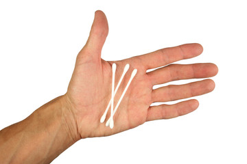 three white cotton swabs for personal hygiene or for the treatment of wounds,  on human palm, isolated white background, close-up