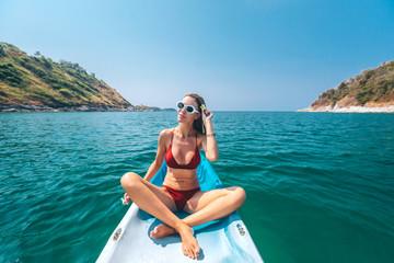 Woman kayaking in Thailand
