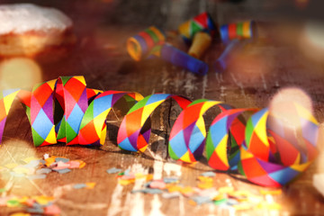 Streamers and confetti on old wood