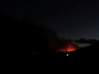 Smoke obstructs twilight from a forest fire in Mahana