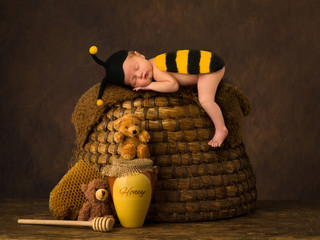 Cute baby sleeping on beehive