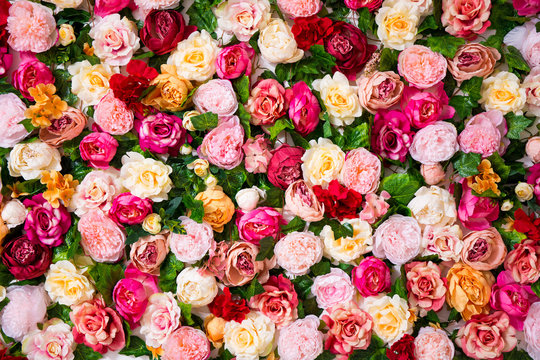 wedding decoration - close up of colorful artificial flowers wall background