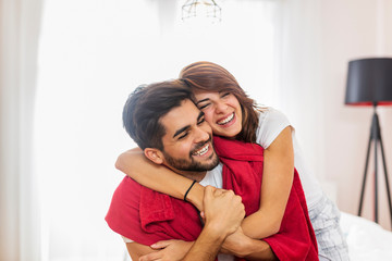 Couple hugging after waking up