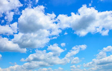 Blue sky with white clouds. Beautiful sky background.