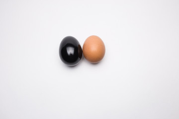 Black and brown egg on a white background close-up