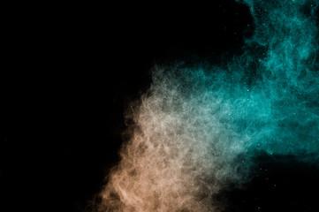 living Coral Color powder effect splash for makeup artist or graphic design in black background
