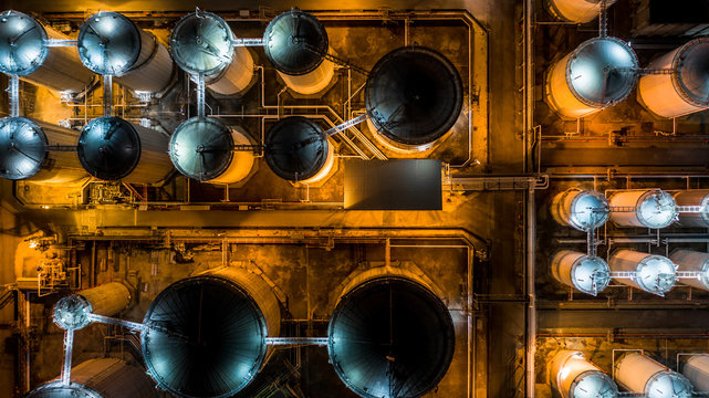 Liquid chemical tank terminal, Storage of liquid chemical and petrochemical products tank, Aerial view at night.