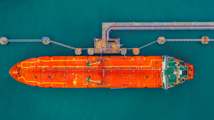 Tanker ship loading in port view from above, Tanker ship logistic import export business and transportation, Aerial view.