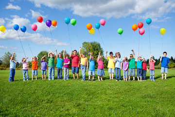 Group of Kids Standing with Balloons Outside Wall mural