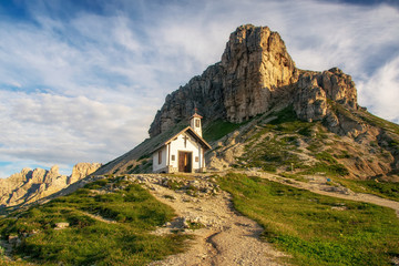 Mountain chapel in Dolomites, Italy at sunny summer day