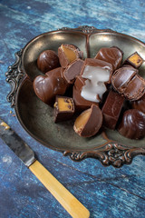 Vintage dish of assorted chocolates cut open to reveal fillings