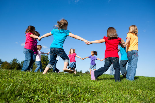 Group of Girls Holding Hands in a Circle Outside - Unity, Friendship