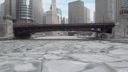 Fototapete - Chicago downtown winter ice frozen river dolly aerial moving