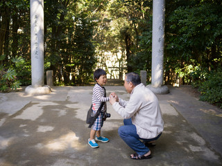 Grandfather soothing grandson outdoors