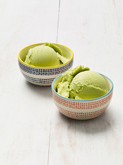 Avocado Ice cream on a white rustic wood background
