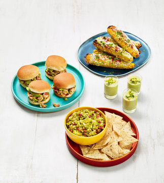 Guacamole, Lobster-Avocado Sliders, Avocado Soup Shooters, and Grilled Corn with Avocado (front to back)
