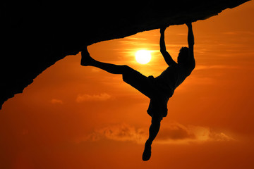 Foto op Canvas Rood traf. Silhouette of asian man climbing rock