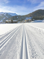 trail for cross-country skiing with scenic winter snow landscape in Tirol in Achenkirch
