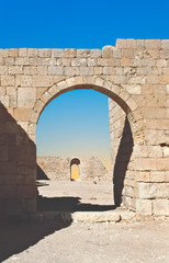 Ancient stone arch and wall at avdat