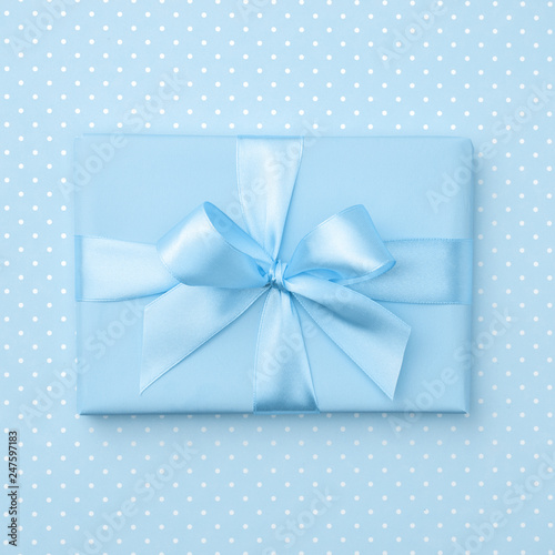 Gift Box With Blue Ribbon Bow On Speckled Background Top View Holiday Concept