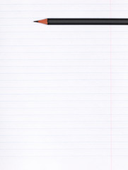 On a sheet of paper notebook with lines lies a black graphite pencil. Copy space. Education concept