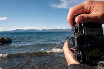 photographer taking photo on the beach