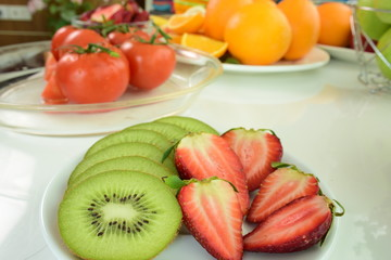 Different kinds of fresh and ripe fruits and vegetables .Colorful fruits and vegetables.fresh fruits on white background.Fresh red tomatoes With drops of water on the tomato skin.
