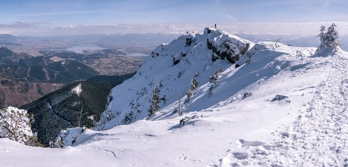 Mountain panorama with mountaineers , in winter