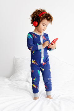 Boy with headphones and mobile phone