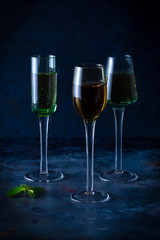 Cordial glasses with different colored liquids