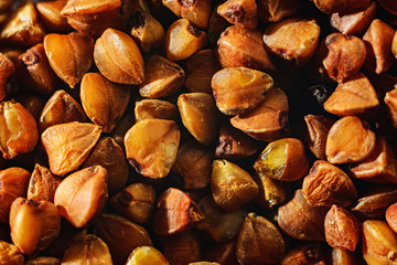 Buckwheat grains are dry brown, texture is macro