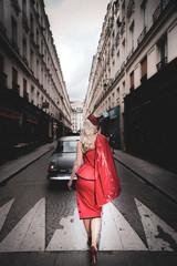 Woman walks toward a vintage car