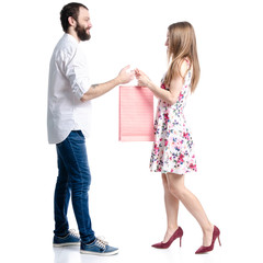 Man with woman young couple package bag in hand gift on white background isolation