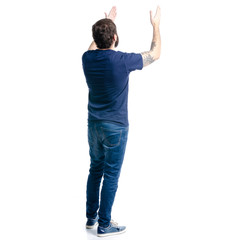 A man in jeans showing on a white background. Isolation, back view