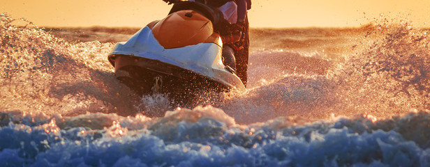 water sports in Goa India.  Motorboat/ jetski or wave runner  in action for tourist riding . Baga beach and vagator. north goa