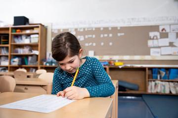 Girl taking test in class