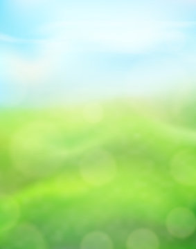 Green nature vertical background on a blurred of grass and sky and bokeh effect. View with copy space add text. Vector