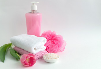 Liquid soap and two towels on a white background.